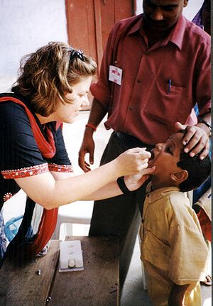 A child receives oral polio vaccine during a 2...
