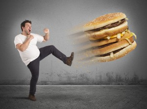 man kicking fat